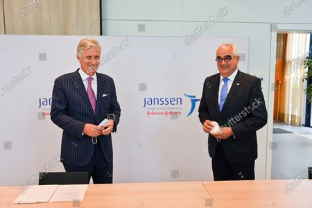 Stock Picture of King Philippe (L) and Janssen Pharmaceutica chief scientific officer Paul Stoffels (C) talk to a scientist at work in the laboratroy during a royal visit to the headquarters of Janssen Pharmaceutica in Beerse