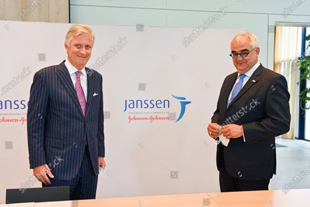 Stock Photo of King Philippe (L) and Janssen Pharmaceutica chief scientific officer Paul Stoffels (C) talk to a scientist at work in the laboratroy during a royal visit to the headquarters of Janssen Pharmaceutica in Beerse