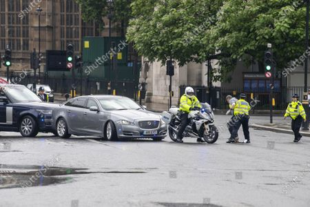 Security car rear-ends Johnson jag as protester leaps out in front of it. A protester leapt in front of a car carrying Boris Johnson, causing a protection vehicle to crash into it. The dramatic security blunder was captured on camera as the Prime Minister was being driven from the Commons in a convoy. A man protesting about Turkish action against Kurdish rebels ran into the road outside the gates to Parliament, causing Mr Johnson's driver to brake sharply. A Range Rover which was following closely behind, carrying a security team, rammed into the back of the £54,000 Jaguar XJ, leaving a large dent in the boot.