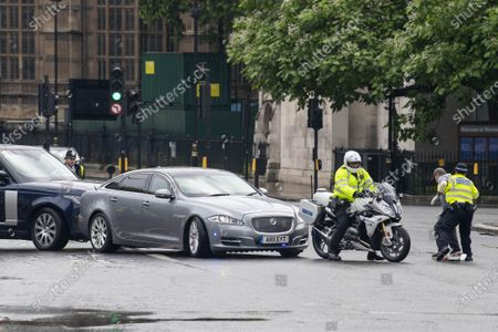 Stock Picture of Security car rear-ends Johnson jag as protester leaps out in front of it. A protester leapt in front of a car carrying Boris Johnson, causing a protection vehicle to crash into it. The dramatic security blunder was captured on camera as the Prime Minister was being driven from the Commons in a convoy. A man protesting about Turkish action against Kurdish rebels ran into the road outside the gates to Parliament, causing Mr Johnson's driver to brake sharply. A Range Rover which was following closely behind, carrying a security team, rammed into the back of the £54,000 Jaguar XJ, leaving a large dent in the boot.