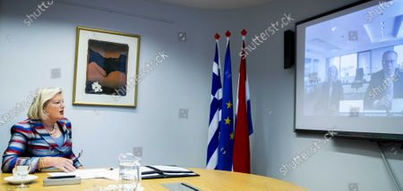 Dutch State Secretary Ankie Broekers-Knol of Justice and Security signs a treaty on the improvement of guardianship system and reception of unaccompanied minor asylum seekers with Greek officials, via video in The Hague, The Netherlands, 18 June 2020.