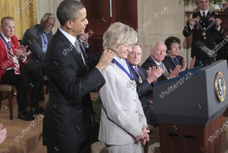 President Barack Obama presents a Medal of Freedom to Jean Kennedy Smith during a ceremony in the East Room of the White House in Washington. Jean Kennedy Smith, the youngest sister and last surviving sibling of President John F. Kennedy, died at 92, her daughter confirmed to The New York Times