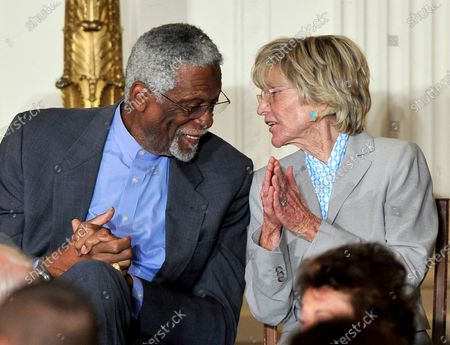 """Bill Russell, left, and Jean Kennedy Smith, right, share a thought during the ceremony where United States President Barack Obama and first lady Michelle Obama honor them and the other recipients of the 2010 Medal of Freedom, """"the Nation's highest civilian honor presented to individuals who have made especially meritorious contributions to the security or national interests of the United States, to world peace, or to cultural or other significant public or private endeavors"""", in a ceremony in the East Room of the White House in Washington, D.C.."""