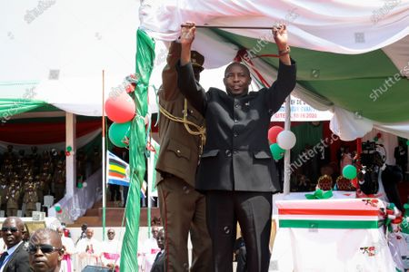 Burundi's President Evariste Ndayishimiye gestures to the crowd after his inauguration in Gitega, Burundi . President Evariste Ndayishimiye took power two months early after the abrupt death of his predecessor Pierre Nkurunziza