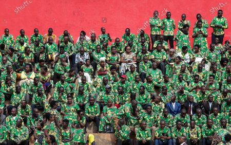 Supporters sit in the stands as they attend the inauguration of Burundi's President Evariste Ndayishimiye in Gitega, Burundi, . President Evariste Ndayishimiye took power two months early after the abrupt death of his predecessor Pierre Nkurunziza
