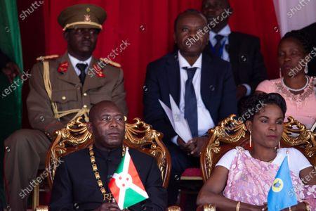 Burundi's President Evariste Ndayishimiye, left, and his wife Angeline Ndayubaha, right, attend his inauguration in Gitega, Burundi, . President Evariste Ndayishimiye took power two months early after the abrupt death of his predecessor Pierre Nkurunziza