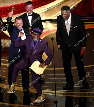 "Spike Lee, foreground center, Charlie Wachtel, from left, David Rabinowitz and Kevin Willmott accept the award for best adapted screenplay for ""BlacKkKlansman"" at the Oscars in Los Angeles. Willmott recently completed a drama, ""The 24th,"" about the Houston Riots, in which some 150 black soldiers marched on Houston in 1917 after a police force evolved from plantation patrols and slave catchers brutalized them"