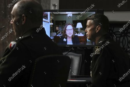 Sen. Deb Fischer, R-Neb., appears via video link as Lt. Gen. Daniel Hokanson testifies during a Senate Armed Services Committee nominations hearing on Capitol Hill, in Washington. Gen. Gustave Perna listens at left