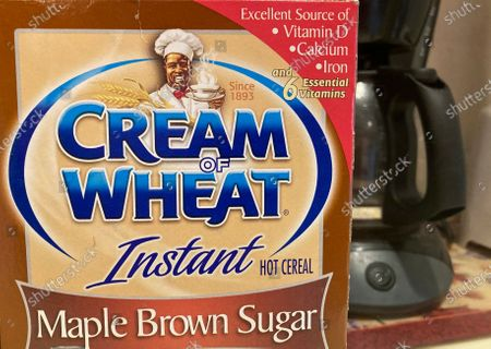 """Stock Picture of Box of Cream of Wheat is displayed on a counter, in White Plains, N.Y. Cream of Wheat and Mrs. Butterworth are the latest brands reckoning with racially charged logos. B&G Foods Inc., which makes Cream of Wheat hot cereal, said it is initiating """"an immediate review"""" of its packaging. A smiling black chef holding a bowl of cereal has appeared on Cream of Wheat packaging and in ads since at least 1918, according to the company's web site"""
