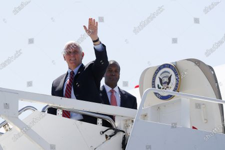 Vice President Mike Pence waves as he arrives on Air Force Two at Selfridge Air National Guard Base in Harrison Township, Mich., . Republican U.S. Senate candidate John James is looking on
