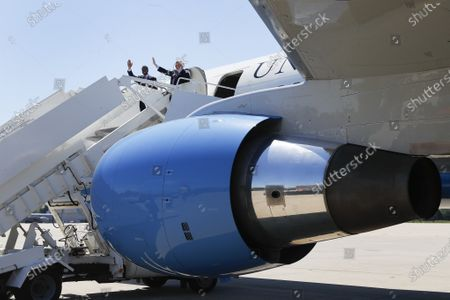 Vice President Mike Pence, right, and Republican U.S. Senate candidate John James wave after the arrival of Air Force Two at Selfridge Air National Guard Base in Harrison Township, Mich