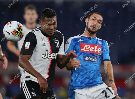 Alex Sandro of Juventus challenges Matteo Politano of Napoli for the high ball.