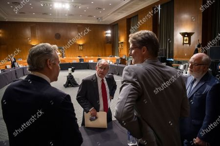 UNITED STATES - JUNE 18: Chairman Jim Risch, R-Idaho, center, talks with, from left, James L. Richardson, director of the State Department's Office of Foreign Assistance, Chris Milligan, counselor with the U.S. Agency for International Development, and Garrett Grigsby, director of the HHS Office of Global Affairs, at the conclusion of a Senate Foreign Relations Committee hearing on 'US International Pandemic Preparedness' in the Capitol in Washington, DC, USA, 18 June 2020.