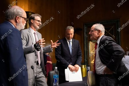 Chairman Jim Risch, R-Idaho, right, talks with, from left, Garrett Grigsby, director of the HHS Office of Global Affairs, Chris Milligan, counselor with the U.S. Agency for International Development, and James L. Richardson, director of the State Department's Office of Foreign Assistance, at the conclusion of a Senate Foreign Relations Committee hearing on 'US International Pandemic Preparedness' in the Capitol in Washington, DC, USA, 18 June 2020.
