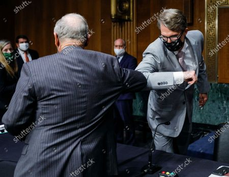 Chairman Jim Risch (R-ID) elbow bumps Chris Milligan, counselor with the U.S. Agency for International Development, before the start of a Senate Foreign Relations Committee hearing on the U.S. international coronavirus disease (COVID-19) response on Capitol Hill in Washington, DC, USA, 18 June 2020.
