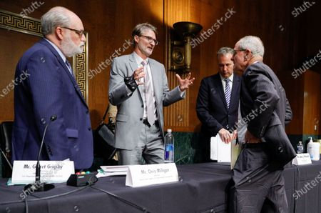 Chris Milligan, counselor with the U.S. Agency for International Development, speaks with committee chairman Jim Risch (R-ID) as Garrett Grigsby, director of the HHS Office of Global Affairs, and James Richardson, director of the State Department's Office of Foreign Assistance, listen following a Senate Foreign Relations Committee hearing on the U.S. international coronavirus disease (COVID-19) response on Capitol Hill in Washington, DC, USA, 18 June 2020.