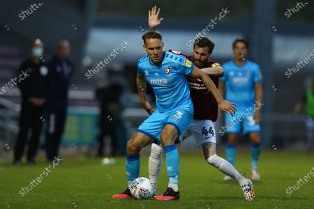 Stock Image of PTS Academy Stadium, Northampton, East Midlands, England; Chris Hussey of Cheltenham Town holds off Paul Anderson of Northampton Town; English Football League Two Playoff, Northampton Town versus Cheltenham Town.