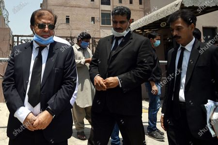 Khawaja Muhammad Imtiaz (L) special public prosecutor for the 2010 murder case of influential Muttahida Qaumi Movement (MQM) senior leader Imran Farooq in London leaves an Anti-Terrorism Court after a verdict in Islamabad, Pakistan, 18 June 2020. A court in Pakistan has sentenced three men to life in prison for the 2010 murder of the Pakistani politician in London. Farooq, 50, was found dead near his residence in the north London neighborhood of Edgware on 16 September 2010. He had suffered multiple stab wounds and head injuries. He had been living in exile in the UK for more than a decade when he died.