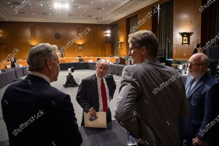 "United States Senator Jim Risch (Republican of Idaho), Chairman, US Senate Foreign Relations Committee, center, talks with, from left, James L. Richardson, director of the State Department's Office of Foreign Assistance, Chris Milligan, counselor with the U.S. Agency for International Development, and Garrett Grigsby, director of the HHS Office of Global Affairs, at the conclusion of a Senate Foreign Relations Committee hearing on ""U.S. International Pandemic Preparedness"" in the Capitol in Washington."