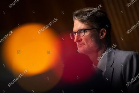 "Stock Image of Chris Milligan, counselor with the U.S. Agency for International Development, testifies during a Senate Foreign Relations Committee hearing on ""U.S. International Pandemic Preparedness"" in the Capitol in Washington."