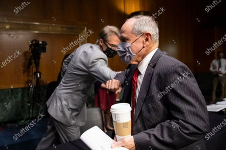 "United States Senator Jim Risch (Republican of Idaho), Chairman, US Senate Foreign Relations Committee, right, elbow bumps Chris Milligan, counselor with the U.S. Agency for International Development, before the start of a Senate Foreign Relations Committee hearing on ""U.S. International Pandemic Preparedness"" in the Capitol in Washington."