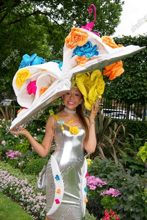 Milliner and designer Tracy Rose from London wears a huge hat and a silver dress to Ladies Day at Royal Ascot