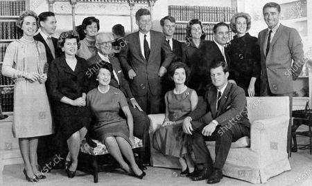 Stock Picture of Then President-elect John F. Kennedy, standing at center, is surrounded by members of his family in home of his parents in Hyannis Port, Mass. Standing, left to right, are Ethel Kennedy, wife of Robert Kennedy; Steven Smith and wife Jean Kennedy Smith; Robert Kennedy; Patricia Kennedy Lawford; Sargent Shriver, Joan Kennedy, wife of Edward Kennedy; and Peter Lawford. Foreground, left to right: Eunice Kennedy Shriver, Joseph P. Kennedy and wife Rose Kennedy seated in front; Jacqueline Kennedy; and Edward Kennedy. The death, of Jean Kennedy Smith, the last surviving sibling of President Kennedy, means Camelot's inner circle is almost gone