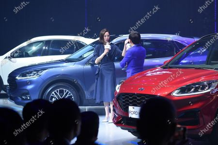 Janine Chang attends a Ford vehicle promotion conference in Taipei, Taiwan, China