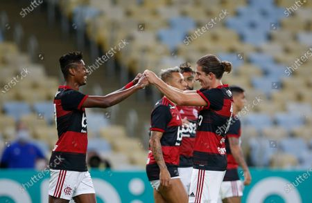 Flamengo's Bruno Henrique, left, celebrates with teammate Filipe Luis after scoring during a Rio de Janeiro soccer league match against Bangu at the Maracana stadium in Rio de Janeiro, Brazi, . Rio de Janeiro's soccer league resumed after a three-month hiatus because of the coronavirus pandemic. The match is being played without spectators to curb the spread of COVID-19