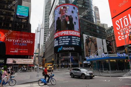 A sign to promote Rick Astley for President appears on the NASDAQ billboard in Times Square.