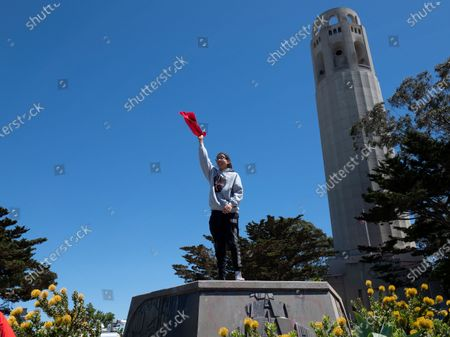 TK Halsey of Lakota Native American tribe and member of the youth American Indian Culture Center stands on the empty pedestal where a statue of Christopher Columbus once stood next to Coit Tower overlooking the Golden Gate Bridge and the San Francisco Bay in San Francisco, USA, 18 June 2020. San Francisco officials quietly removed the 4,000 pound statue in the early morning. For many Native Americans the statue has always been associated with slavery, subjugation, and conquest.