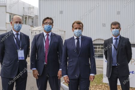 Board Director of Sanofi Serge Weinberg, French President Emmanuel Macron, CEO of Sanofi Paul Hudson, and President of Sanofi France Olivier Bogillot arrive at the French drugmaker's vaccine unit Sanofi Pasteur plant in Marcy-l'Etoile, near Lyon, central France, on June 16, 2020. The visit comes after rival pharmaceutical company AstraZeneca this weekend announced a deal to supply 400 million vaccine doses to EU countries, including France.