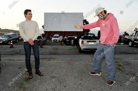 """Dave Franco, left, director and co-writer of """"The Rental,"""" poses alongside cast member Dan Stevens at an advance screening of the film at the Vineland Drive-In, in City of Industry, Calif"""