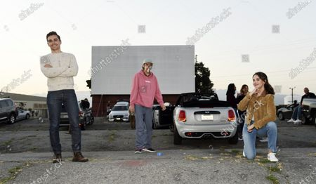 "Dave Franco, left, director/co-writer of ""The Rental,"" and cast members Dan Stevens, center, and Alison Brie maintain social distance as they pose for photos before an advance screening of the film at the Vineland Drive-In, in City of Industry, Calif"