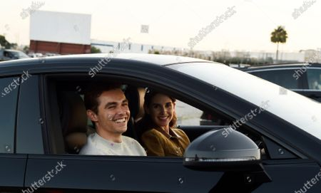 "Dave Franco, left, director/co-writer of ""The Rental,"" poses with his wife, cast member Alison Brie, inside their car before an advance screening of the film at Vineland Drive-In, in City of Industry, Calif"