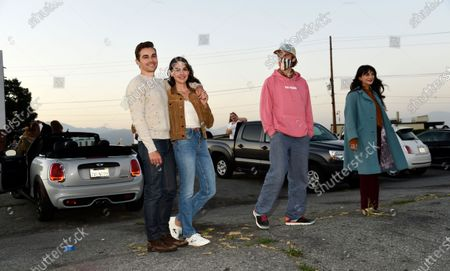 "Dave Franco, left, director/co-writer of ""The Rental,"" poses with his wife, cast member Alison Brie, and cast members Dan Stevens and Sheila Vand, right, before an advance screening of the film at Vineland Drive-In, in City of Industry, Calif"