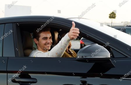 """Dave Franco, director/co-writer of """"The Rental,"""" gives the thumbs-up to photographers before an advance screening of the film at Vineland Drive-In, in City of Industry, Calif"""