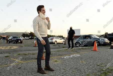 """Dave Franco, director/co-writer of """"The Rental,"""" takes off his mask as he arrives at an advance screening of the film at Vineland Drive-In, in City of Industry, Calif"""