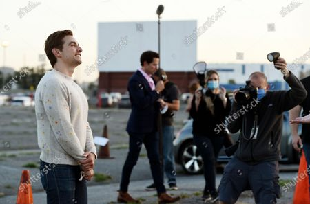 """Dave Franco, left, director/co-writer of """"The Rental,"""" faces photographers upon arriving at an advance screening of the film at Vineland Drive-In, in City of Industry, Calif"""