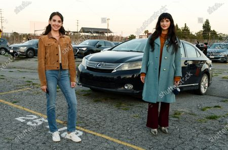 """Stock Picture of Alison Brie, left, and Sheila Vand, cast members in """"The Rental,"""" pose together before an advance screening of the film at Vineland Drive-In, in City of Industry, Calif"""