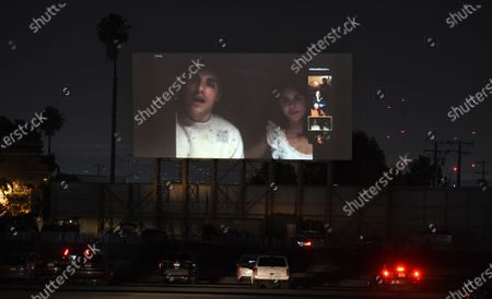 """Dave Franco, left, director/co-writer of """"The Rental,"""" and his wife, cast member Alison Brie, take part in a Zoom Q&A session from their car following an advance screening of the film at the Vineland Drive-In, in City of Industry, Calif"""