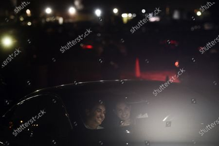 "Dave Franco, left, director/co-writer of ""The Rental,"" and his wife, cast member Alison Brie, take part in a Zoom Q&A session from their car following an advance screening of the film at the Vineland Drive-In, in City of Industry, Calif"