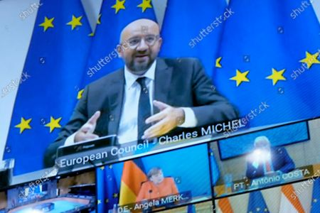 A television screen shows European Council President Charles Michel (top) and European Union (EU) leaders such as German Chancellor Angela Merkel (2-R, bottom) and Portuguese Prime Minister Antonio Costa (R, bottom) taking part in a virtual European summit, in Brussels, Belgium, 19 June 2020. In the video conference, the leaders are discussing the creation of a fund to help member states recover from the economic impact of the ongoing COVID-19 pandemic caused by the SARS-CoV-2 coronavirus, as well as lay out a new long-term budget for the bloc.