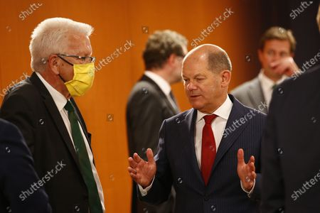 Finance Minister and vice Chancellor, Olaf Scholz (SPD), Baden-Wuerttemberg, M.P. Winfried Kretschmann arrive for a meeting of German Federal State Premiers at the Chancellery. The German Prime Ministerial Conference took place earlier this day in Berlin.