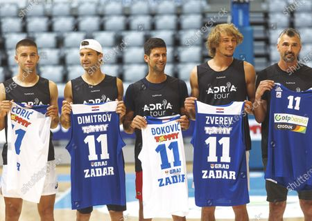 Serbian tennis player Novak Djokovic (C) poses with Borna Coric (1st L), Grigor Dimitrov (2nd L), Alexander Zverev (2nd R) and Goran Ivanisevic after a friendly basketball match ahead of the Adria Tour humanitarian tennis tournament in Zadar, Croatia, June 18, 2020. Adria Tour is organized by Serbia's tennis player Novak Djokovic in order to promote sports, positive values and fair play, and also to raise funds for those who need help. Zadar will host the tournament featuring Djokovic and top Croatian tennis players from June 19 to 21.