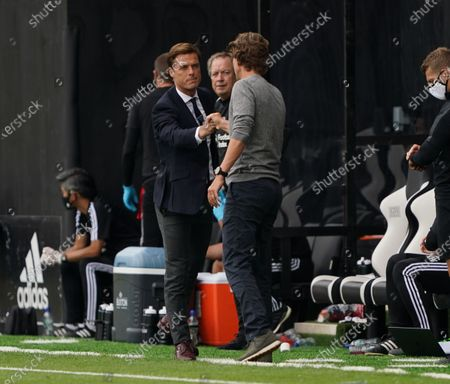 Fulham manager Scott Parker and Brentford manager Thomas Frank touch fists at fulltime