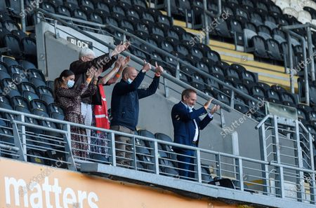 Owner of Charlton Athletic Paul Elliott looks delighted and applauds the team off the pitch after a hard fought away win at Hull City