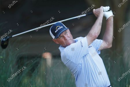 Davis Love III follows his shot from the second tee, during the second round of the RBC Heritage golf tournament, in Hilton Head Island, S.C