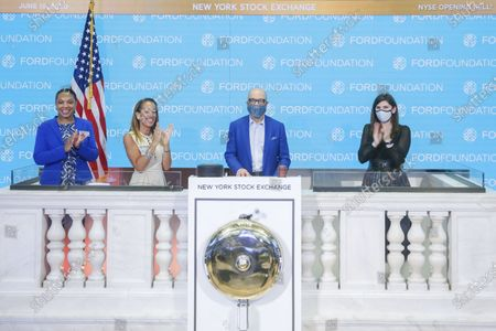 Stock Image of Ford Foundation rings The Opening Bell to honor Ford's $1B Social Bond for Nonprofits and Juneteenth. Darren Walker, President of the Ford Foundation, joined by Stacey Cunningham, NYSE President, ring The Opening Bell together on the NYSE podium on in New York