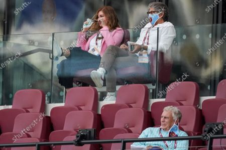Karren Brady, Vice-Chairman of West Ham United and her husband Paul Peschisolido, and Sir Trevor Brooking wear masks as they watch the game from the directors box